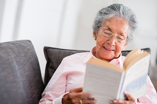 bigstock-Elder-woman-reading-a-book-at--45684340