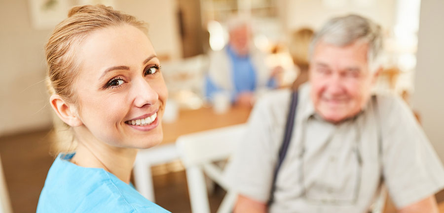 bigstock-Smiling-caregiver-woman-or-ger-278725483-new